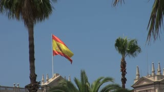 Spanish Flag Waving Atop Building 2
