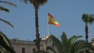 Spanish Flag Waving Atop Building