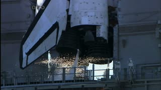 Sparks and Flames Coming Out of Space Shuttle Engine