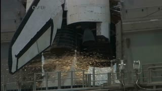 Sparks Ignite Shuttle Engine Rockets