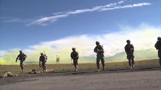 Special forces soldiers walk towards camera slow motion