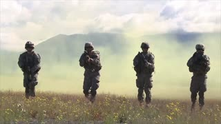 Special forces soldiers walk towards camera