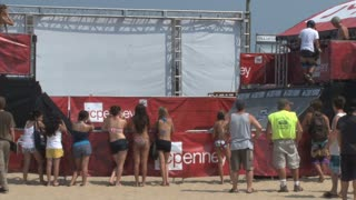 Spectators and Skateboarder on Halfpipe at Beach