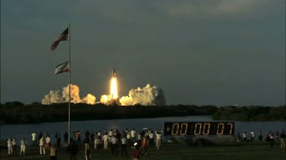 Spectators Cheering on Space Shuttle Lift Off