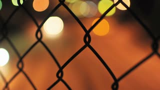 Speeding Bokeh Lights Through Fence