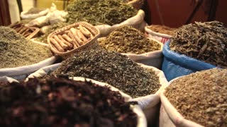 Spices in a market in Morocco at night pan