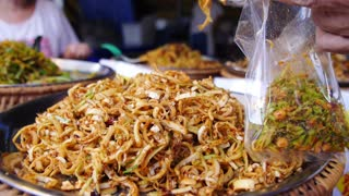 Spicy Street Food Takeaway at Thai Market. Closeup.