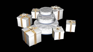 Spinning cake and white boxes with ribbon
