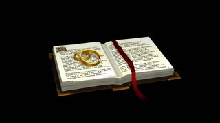 Spinning  gold ring and book with ribbon