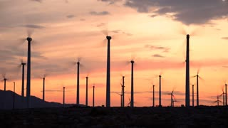 Spinning Windmills In Field Timelapse