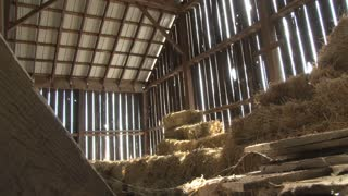 Stacked Bales of Hay in a Barn 2