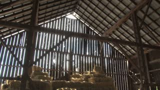 Stacked Bales of Hay in a Barn