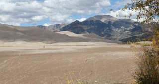 Static shot of desert floor leading up to Great Sand Dunes National Park