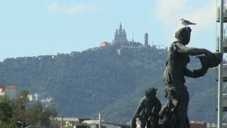 Statue in Foreground with Building on Mountain in Background in Spain