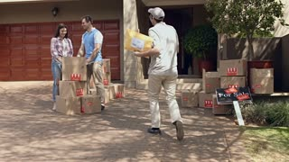 Steadicam shot of delivery man or courier, delivery parcel to happy couple while they moving into new house.