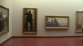 Steadicam Shot Of Family Looking At Painting