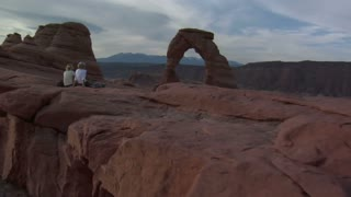 Steadicam Shot Of Two Ladies At Delicate Arch Arches National Park