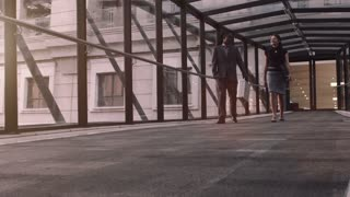 Steadicam shot of your diverse business team, talking as they are on there way to a early morning meeting at sunrise.