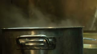 Steam Comes From Metal Pot On Stove
