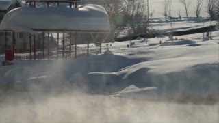 Steaming Pond In Winter