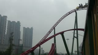Steel Coaster Ride on Cloudy Day