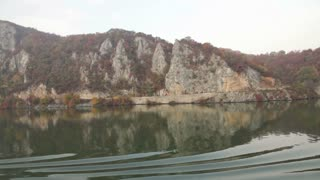 Steep Mountains Along Romanian Waterway
