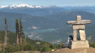 Stone Statue Overlooking Scenic Mountain Range