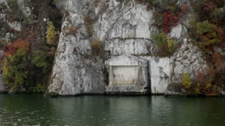 Stone Structure on Side of Mountain Along the Water