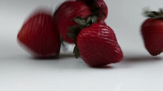 Strawberries Dropping Onto Table