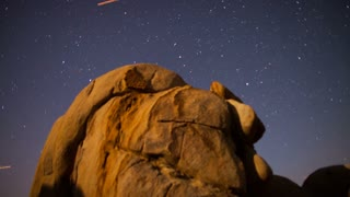 Streaking Stars Over Rock Formation