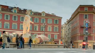 street in european city. People walking relaxing enjoy evening and meeting with friends. fountain in historic center. tram rides in the evening. time lapse