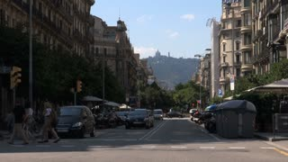 Street Traffic with Mountain in Background in Spain