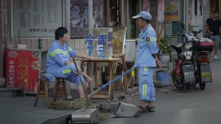 Street Workers on a Break In China