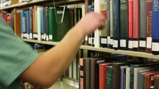 Student Pulls Out Book in Library