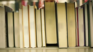 Student Pulls Out Book Reverse Angle