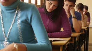 Students and university education, portrait of hispanic woman during test at college