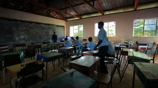 Students Taking a Test in Kenya Classroom 45
