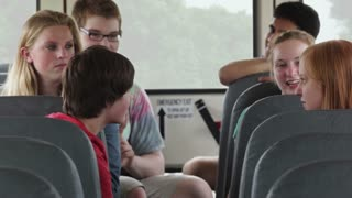 Students Talking on School Bus