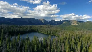 Stunning aerial flight over Lost Lake in Vail Colorado in the Rocky Mountains in Summer