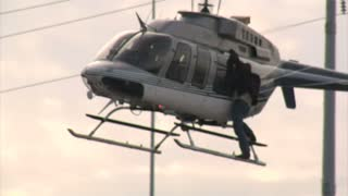 Stuntman Clings To Helicopter In Flight