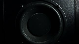 Subwoofer (bass loud speaker) in action. Super slow motion low key shot