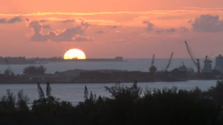 Sun Dipping Behind Ocean Loading Docks 2