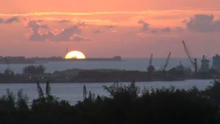 Sun Fading Behind Ocean Loading Docks
