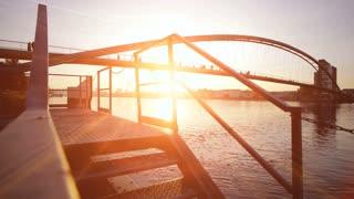 sun flare. romantic sunset. bridge landscape. lake pond