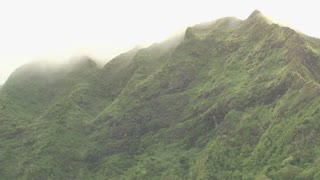 Sun Peaking Through Top of Foggy Hawaii Mountains