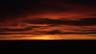 Sun Setting Amid Clouds