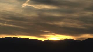 Sun Setting Behind Mountain Range