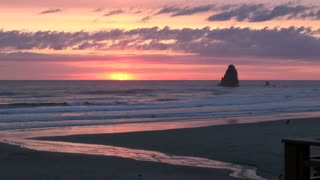 Sun Setting on Horizon at Cannon Beach