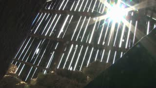 Sun Shining Through Cracks in Barn