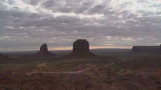 Sun Shining Through Monument Valley Clouds